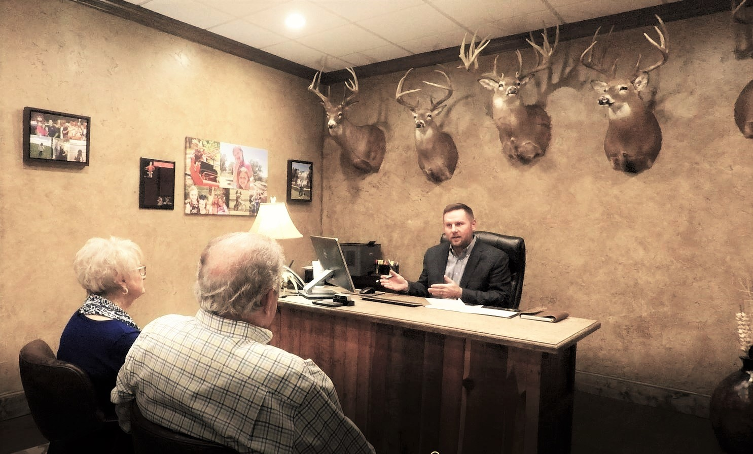 Brad Jones meeting with two of his insurance customers.